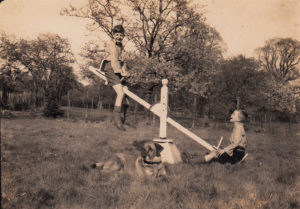 two boys 1800s seesaw